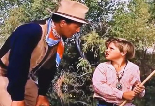 John Wayne Helps Kid Learn To Swim Like A Badass