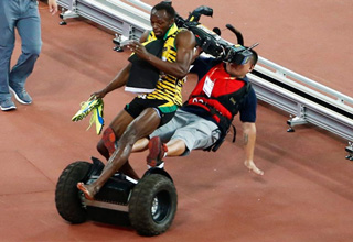 Cameraman On Segway Takes Out Usain Bolt
