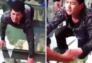 See-Through Skywalk In China Becomes Nightmare Crossing for Terrified Man