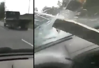 Lucky Driver Survives a 2x4 Through The Windshield