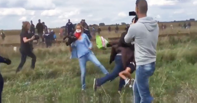 Camerawoman Blatently Trips Refugee Trying To Escape