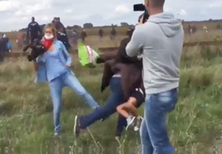 Camerawoman Trips Refugee Carrying A Child