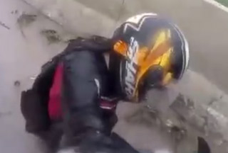 Biker Wipes Out But Keeps His Cool And Save
