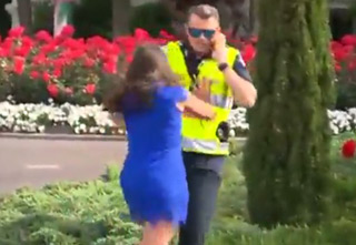 Angry Woman Pushes Cop Into The Bushes