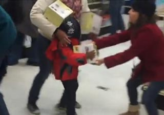 Woman Steals From Child During Black Friday Madness