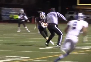 High School Referee Lays Out Receiver Forcing Fumble