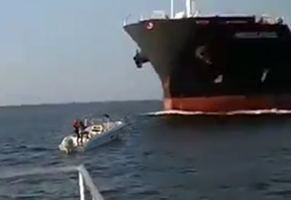 Small Boat's Near Miss With Massive Tanker