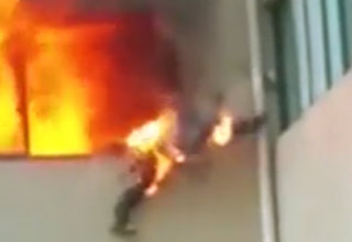 Fireman Catches On Fire And Jumps Out Of Window