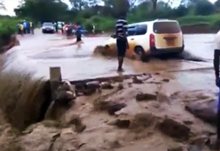 Idiot Driver Attempts To Cross A Flooded Road