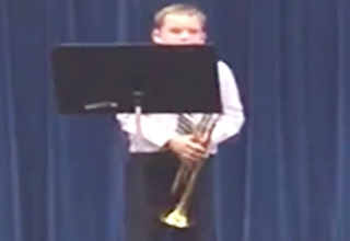 Kid Celebrates Amazing Trumpet Solo