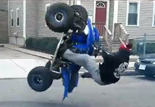 ATV Stunt Ends With A Hard Wipeout