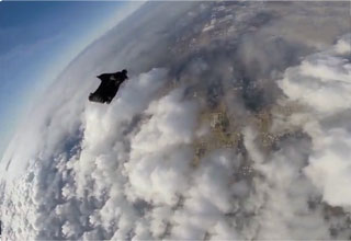 Guy Has Amazing Skydive Above the Clouds