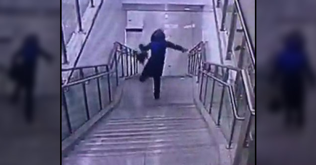 woman falling down stairs