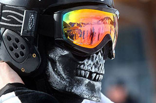 snowboarding helmet with skull mask and goggles