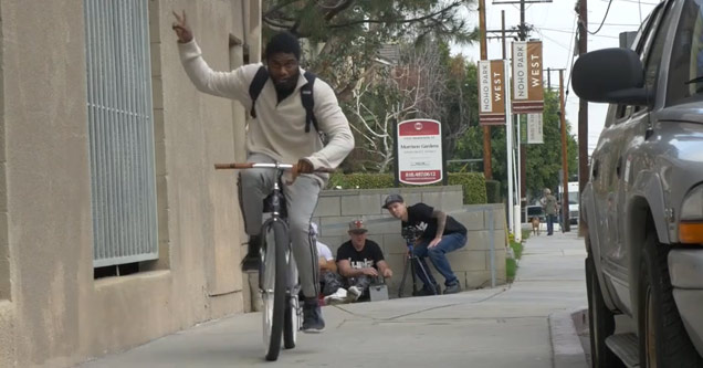 guy throws up peace sign after stealing a bike