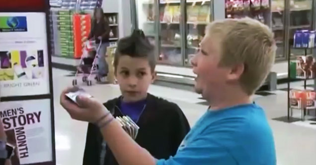 two kids talking to a police officer
