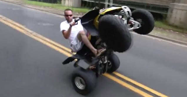guy doing a wheelie on a 4-wheeler