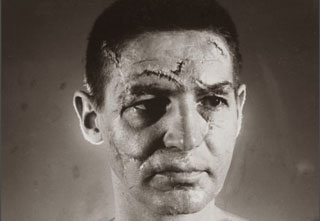 A picture of goalie Terry Sawchuk before hockey masks were a thing, 1966.