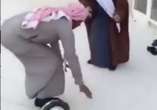 Middle Eastern Guy Has Glass Door Wipeout on Hoverboard