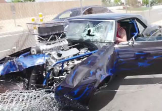 hotrod camaro wrecked after hitting fence