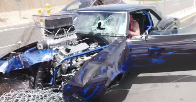 hotrod camaro wrecked after hitting fence