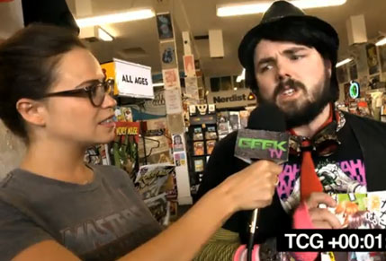 awkward guy being interviewed at comic book store