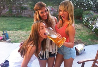 funny picture of 3 girls drinking a beer
