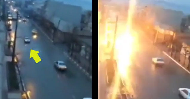 a car driving is suddenly hit by something and catches on fire