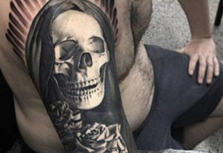 close up of grim reaper tattoo