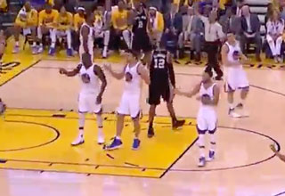 Three Golden State Warriors Players Draymond Green, Zaza Pachulia and Steph Curry do the same arm movement at the same time.