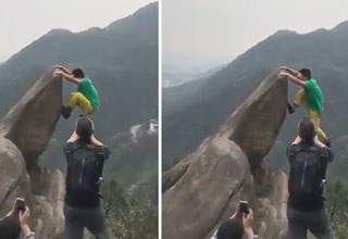 man falls while hanging from the edge of a cliff