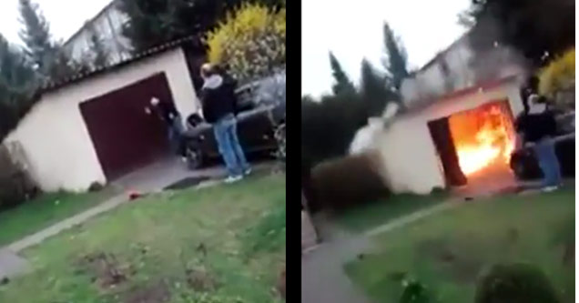 man holding garage doors closed experiences a sudden explosion