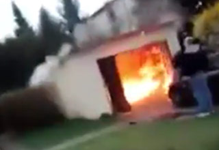 small garage on fire after explosion