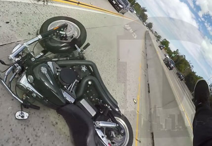 bike laying on road after crash with car
