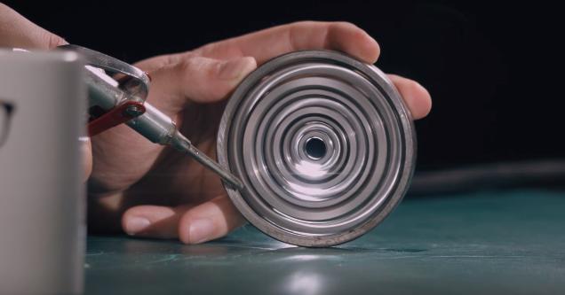 man holding a ball bearing spinner he built