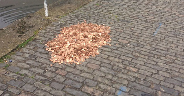 15000 assorted copper coins on sidewalk