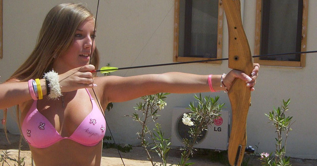 busty woman in bikini shooting bow and arrow