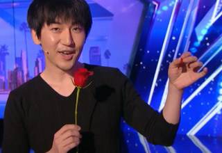man holding rose doing magic trick on americas got talent