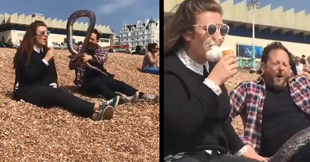 woman eating ice cream is scared by fake snake and gets it all over
