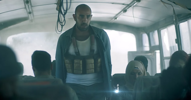 man wearing suicide bomber vest