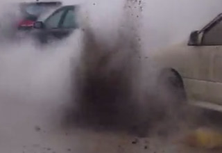 raw sewage erupting from sewer getting on cars
