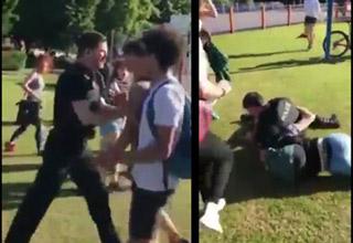 police officer grabbing a teen and tackling him