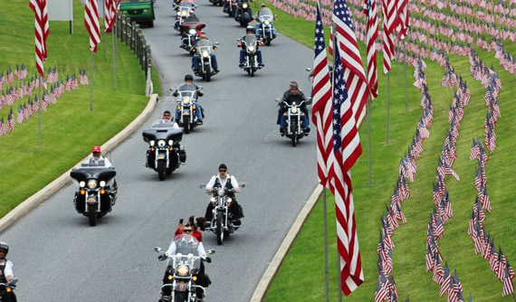 biker riding through us memorial grave site