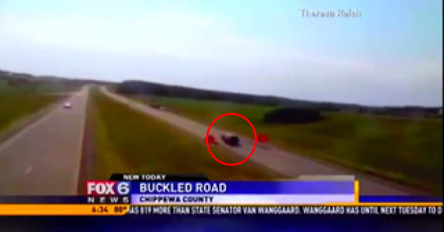 buckled road sends taxpayer flying