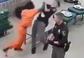 a man in orange jumpsuit punches correctional officers
