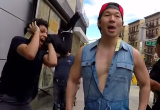 asian man wearing romper walking around the street