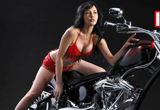 sexy woman in red on motorocycle