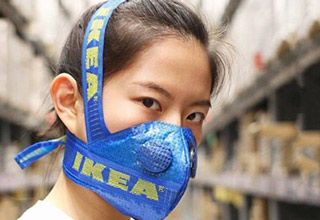 girl wearing ikea bag like mask