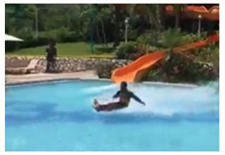 man coming down waterslide makes smooth exit