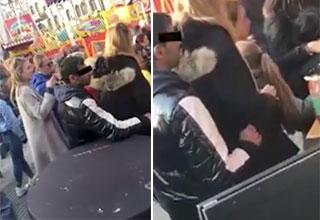 pickpocket put into a headlock after stealing an iPhone